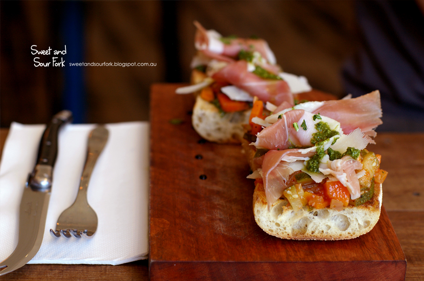 Open Baguette with Grana Padano and Ham, Roast Vegetable, and Pesto ($11.5)