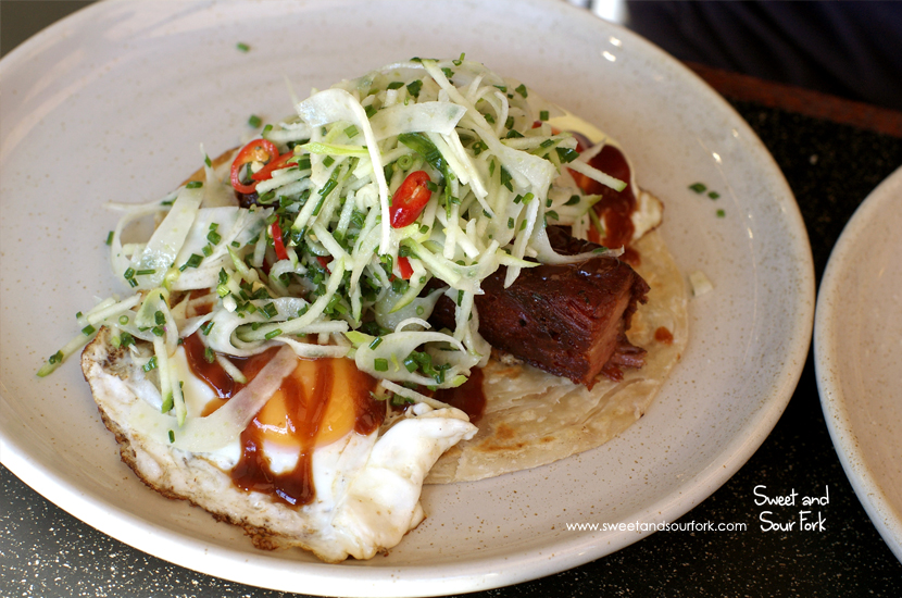 Slow Braised Ham Hock, Roti Bread, Chilli BBQ Sauce, Two Fried Eggs, Fennel & Apple ($20)