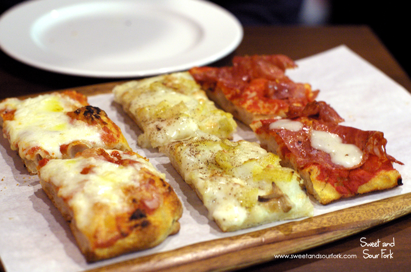 (Left to Right) Margherita ($30/kg)/Potato and Leek, Taleggio, and Nutmeg Pizza ($35/kg)/Salami and Taleggio Pizza ($40/kg)