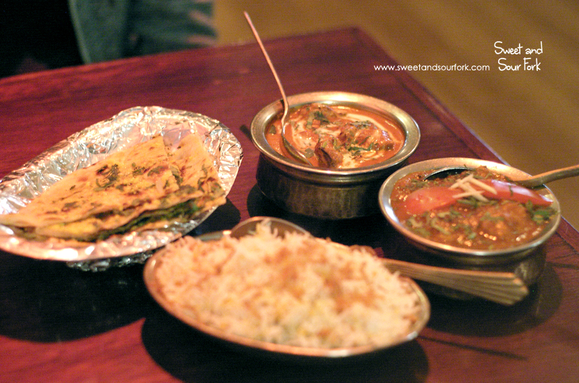Goan Fish Curry ($16.99)/Butter Chicken (16.99)/Saffron Rice ($4.99)/Garlic Naan ($3.99)